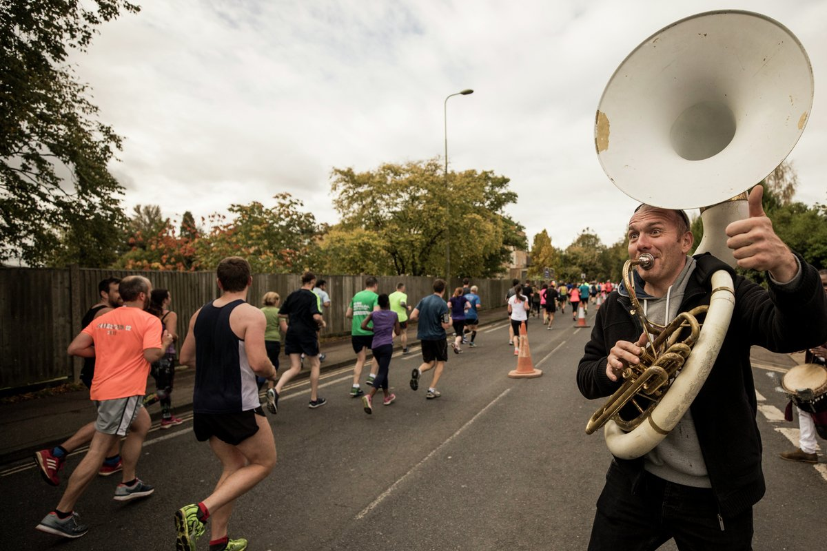 A tuba playing on the roads of the Oxford Half