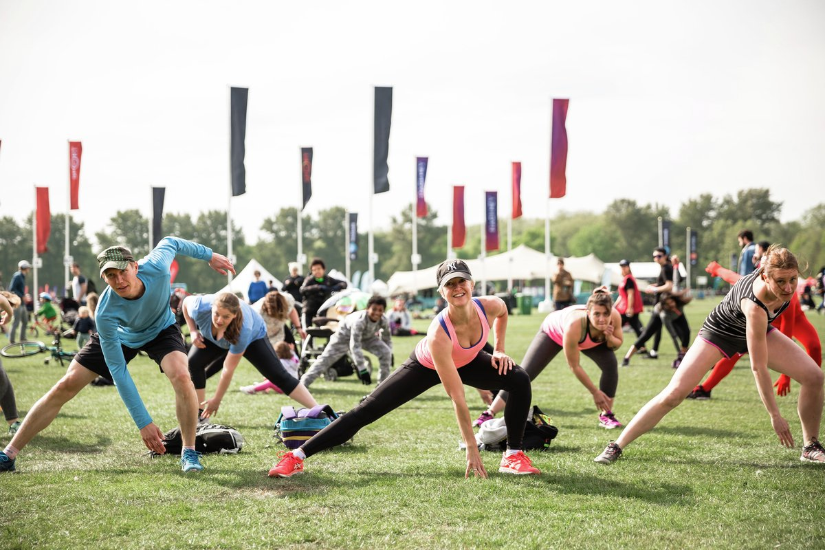 Festival goers stretching at Virgin Sport Hackney 2017