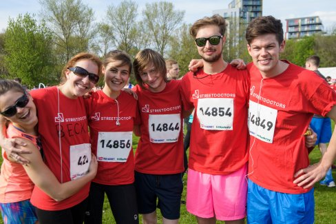 A group of charity runners at a Virgin Sport Festival of Fitness event.