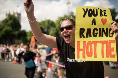You're a raging hottie, says the sign at the British 10k route.