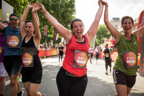 Hands up: Enthused runners at the Virgin Sport British 10k, holding hands