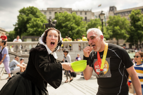 Florence Nightingale at the Virgin Sport British 10k, feeding a runner a jelly baby.