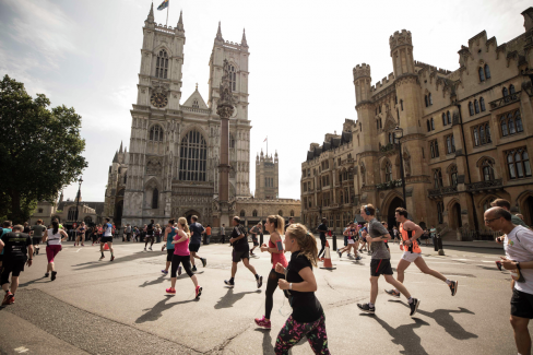 Runners running past Westminster Abbey at the 2017 Virgin Sport British 10k
