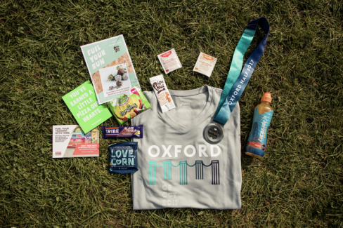 The 2017 Virgin Sport Oxford race pack—complete with an ASICS tee and medal.