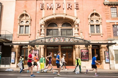Running at the 2017 Hackney Half marathon in front of the Empire Theater.