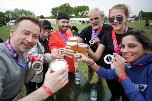 A group of friends drinking a pint of beer after the Hackney Half