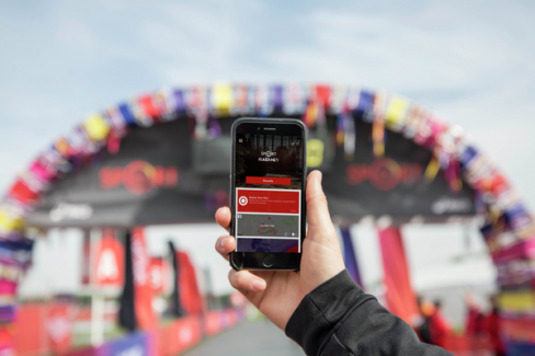 The Virgin Sport app held in a hand at the Hackney Half marathon start