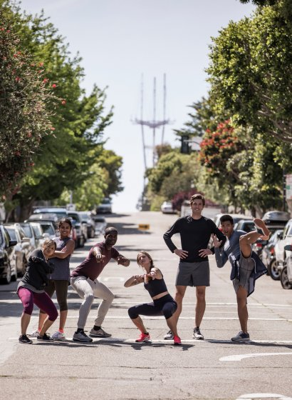 A group of runners hanging out in the streets of San Francisco. Virgin Sport SF.