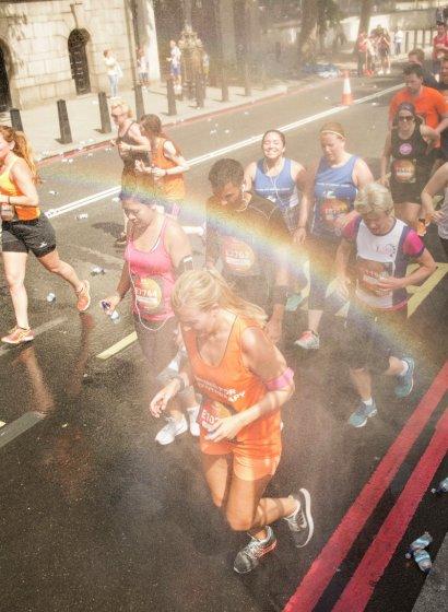 A runner runs through a rainbow.